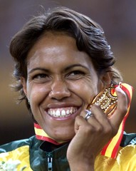 Australia's Cathy Freeman smiles after receiving her gold medal for the 400 meters at the 7th IAAF w..