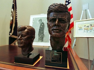 A bronze bust of former President John F. Kennedy (R), on display at a press preview in New York Mar..
