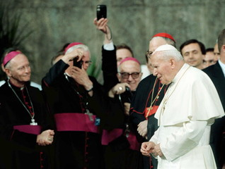 Bishops take photos of Pope upon his arrival at airport in Wroclaw.