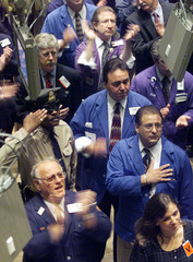 TRADERS LISTEN TO STAR SPANGLED BANNER AT NEW YORK STOCK EXCHANGE.