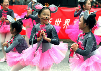 Dancing ballerina 'rats' perform for the Hong Kong crowds at a Chinese New Year parade February 19. ..