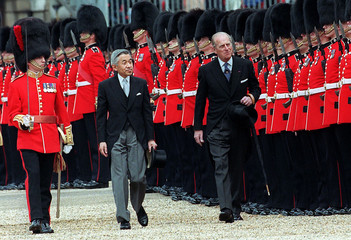 EMPEROR AKIHITO OF JAPAN REVIEWS GUARD OF HONOUR WITH BRITAIN'S DUKE OF EDINBURGH.
