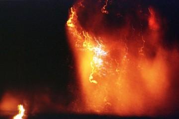 AN EXPOSION FOLLOWED BY A HUGE FIRE.