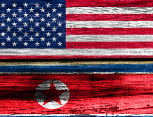 The wooden surface. Flags: USA, North Korea
