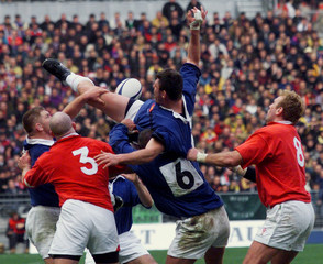 FRANCE'S LIEVREMEONT IS PULLED BACK DURING WALV FRANCE FIVE NATIONS RUGBY GAME.