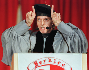 Rock musician David Bowie jokingly makes devils horns in front of his head as he delivers the commen..