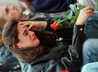 WOMAN CRIES AT CANDLELIGHT VIGIL IN DENVER.