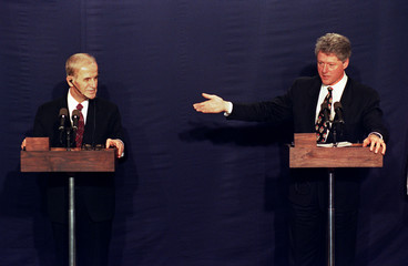 Syrian President Hafez al - Assad (L) and US President Bill Clinton after their meeting in Geneva..