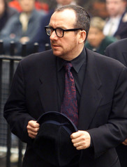 Elvis Costello arrives for the funeral of Dusty Springfiled at St Mary's Church in Henley on Thames,..
