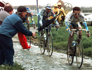French Frederic Moncassin leads in front Belgium Johan Museeuw in Haussy during the 96th edition of..