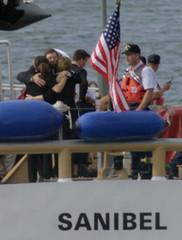 FAMILIES HUG BEFORE BURIAL AT SEA OF JFK JR.
