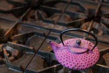 Purple Teapot on Stove