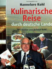 "German Chancellor Helmut Kohl displays a cookery book titled ""A culinary journey through Germany"" wi.."