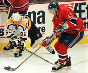 PITTSBURGH'S STRAKA TRIES TO TAKE PUCK FROM MONTREALS BRISEBOIS.