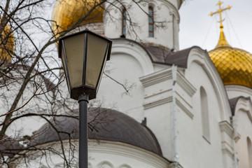Vintage black lantern on a city street