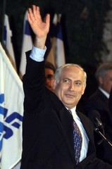 Prime Minister Benjamin Netanyahu waves to Likud party supporters as he begins a speech April 18 nig..