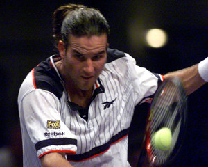 PATRICK RAFTER RETURNS A BALL IN VIENNA.