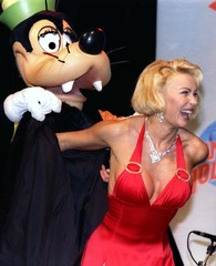 """French tv anchorwoman Marlene is dressed by cartoon character """"Goofy"""" during the opening ceremony of.."""