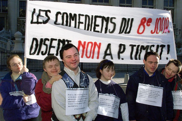 Belgian actor Pascal Duquenne (3rd L),  takes part in a demonstration outside the Paris law courts J..