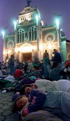A mother and her daughter sleep after their pilgrimage to the Basilica de Los Angeles in Cartago, Au..