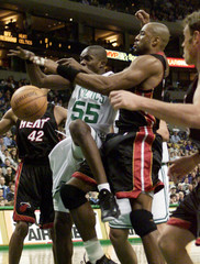CELTICS WILLIAMS COMPETES WITH HEATS MOURNING FOR REBOUND.
