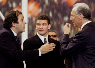PLATINI, JENSEN AND BECKENBAUER AT DRAW FOR NEXT YEAR'S EUROPEAN SOCCER CHAMPIONSHIP.