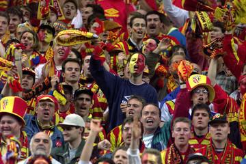 Supporters of the Racing Club de Lens celebrate as Daniel De Sa Moreira scored for his team during t..