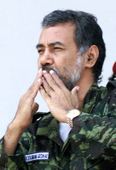 East Timorese pro-independence leader Xanana Gusmao blows a kiss to his supporters before giving a h..