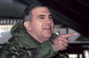 General George Joulwan points finger during brief statement after arriving at Belgrade's airport Dec..