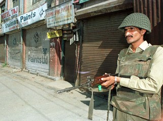 INDIAN TROOPERS GUARDS STREET IN SRINAGAR.