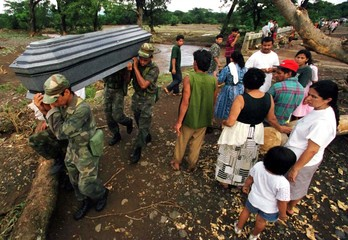SALVADORAN SOLDIERS CARRY COFFINS OF FLOOD VICTIMS.
