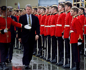 US President Bill Clinton reviews Canadian military cadets April 3 in the rain at Vancouver's airpor..