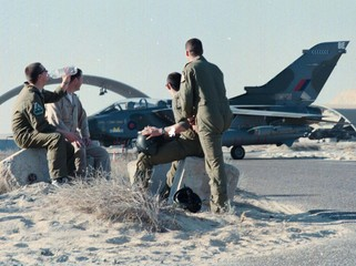 BRITISH ROYAL AIRFORCE PILOTS TAKE A BREAK AFTER FOUR DAYS OF AIR STRIKES ON IRAQ.