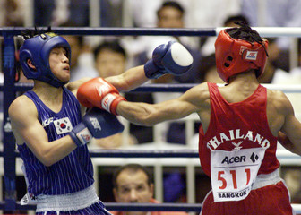 THAILAND'S PHOSUWAN IN BOXING ACTION AT ASIAN GAMES 51KG BOXING SEMIFINALS IN BANGKOK.