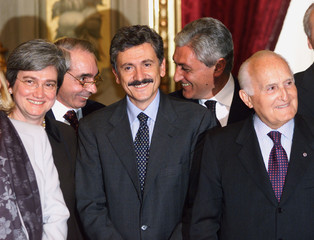 Italian new Prime Minister Massimo D'Alema (C) smiles as he poses with (L to R) new Minister of Heal..