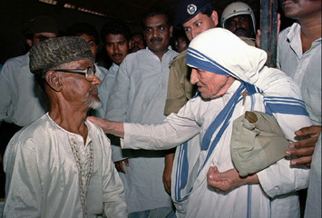 Nobel Peace Laureate Mother Teresa talking to a Bangladeshi man after she opens an old people's home..