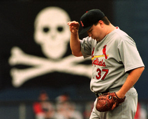 ST LOUIS PITCHER BOTTENFIELD PAUSES IN FRONT OF SKULL AND CROSSBONES.
