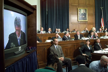 The videotape of US President Bill Clinton's deposition in the Paula Jones case is played before the..