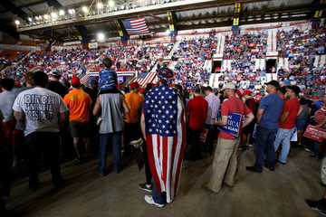 People listen to a speaker before a U.S. President Donald Trump rally in Harrisburg