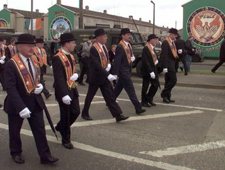 Members of the Portadown Orange Lodge march down the nationalist area of Garvaghy Road July 6. Rioti..