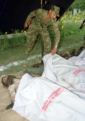 INDIAN SOLDIER COVER THE BODIES OF SEVEN SEPARATISTS.