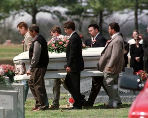 Pall bearers carry the casket of 12-year-old Paige Ann Herring at a Jonesboro cemetery March 27 duri..