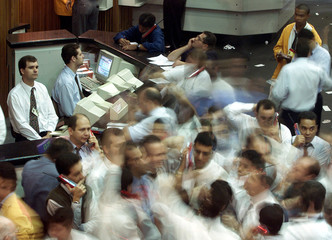 TRADERS WALKS AT THE FLOOR OF SAO PAULO STOCK EXCHANGE DURING MORNING TRADING.