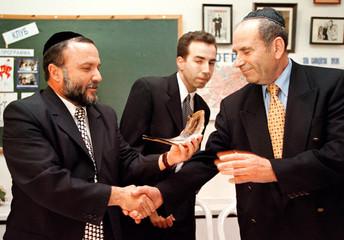 ISRAELI MINISTER YITZHAK COHEN PRESENTS A HORN TO LEONID LEVIN.