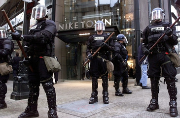 Seattle riot police guard the front of a Nike store in downtown Seattle after several thousand prote..
