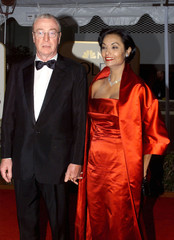 Actor Michael Caine and his wife Shakira Baksh arrive at the 56th annual Golden Globe awards ceremon..