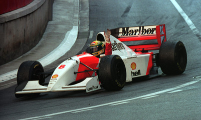 Ayrton Senna of Brazil in his McLaren Ford raises his hand after winning the 1993 Monaco Grand Prix ..