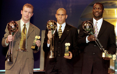 Brazilian soccer player Ronaldo Lima (C), England's Alan Shearer (L) and Liberian George Weah hold t..