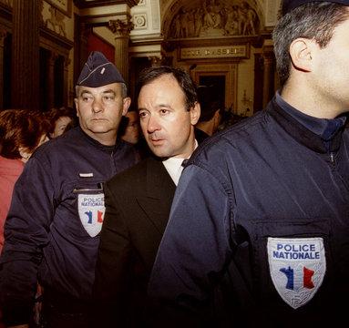 Businessman Marc Bathier (c) leaves the court of Lyon April 20 after the sentence of the trial Noir/..