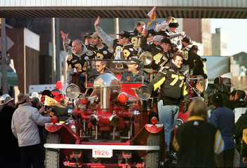 TIGER-CATS PLAYERS CELEBRATE GREY CUP WIN AT VICTORY PARADE.